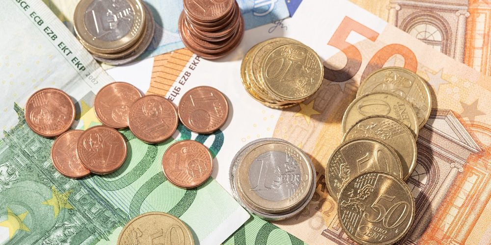 Money background. Euro money banknotes and coins. European union economy concept. Top view